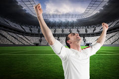 Composite image of excited football fan cheering Royalty Free Stock Photo