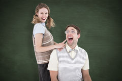A Composite image of excited geeky hipster couple Stock Image