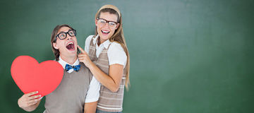 Composite image of excited geeky hipster and his girlfriend Royalty Free Stock Images