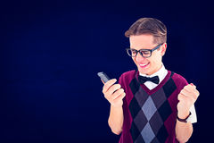 Composite image of excited geeky hipster texting on the phone Stock Photography
