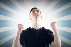 Composite image of excited rugby player gesturing victory Royalty Free Stock Photo