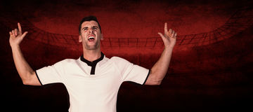 Composite image of excited rugby player pointing up Royalty Free Stock Photography
