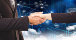 Composite image of executives shaking hands stock photos