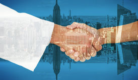 Composite image of extreme closeup of a doctor and patient shaking hands Royalty Free Stock Images