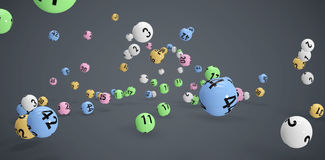 Composite image of falling colourful lottery balls Royalty Free Stock Image