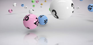 Composite image of falling lottery balls. Falling lottery balls  against grey background Royalty Free Stock Photography