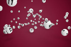 Composite image of falling lottery balls. Falling lottery balls  against pink background Stock Image