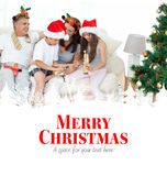 Composite image of family on christmas day looking at their presents at home Royalty Free Stock Images