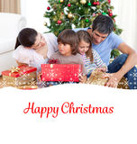 Composite image of family christmas portrait Royalty Free Stock Photos