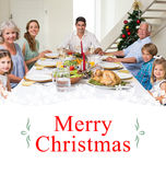 Composite image of family having christmas meal together Royalty Free Stock Image