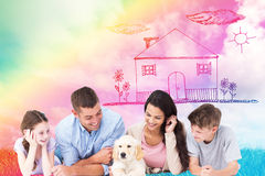 Composite image of family looking at puppy while lying Royalty Free Stock Photography