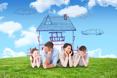 Composite image of family lying with head in hands Stock Image
