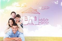 Composite image of family lying on top of each other Stock Images