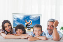 Composite image of family in sitting room smiling at camera Royalty Free Stock Images