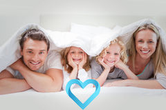 Composite image of family under the cover Stock Photos