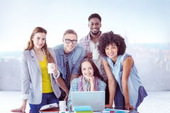 Composite image of fashion students working as a team Royalty Free Stock Photography