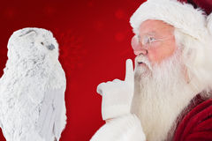 Composite image of father christmas asks for quiet Royalty Free Stock Images