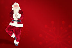 Composite image of father christmas doing some yoga Royalty Free Stock Photography