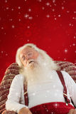 Composite image of father christmas sleeps on the armchair Royalty Free Stock Photo