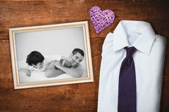 Composite image of father and his son having fun on a bed Royalty Free Stock Photos