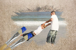 Composite image of father and son on the beach Royalty Free Stock Photo