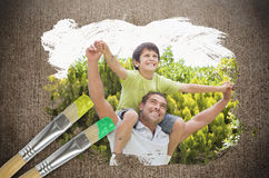 Composite image of father and son in the park Stock Image