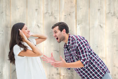 Composite image of fearful brunette being overpowered by boyfriend Stock Photography