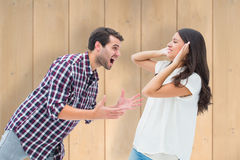 Composite image of fearful brunette being overpowered by boyfriend Royalty Free Stock Image