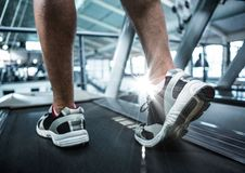 Composite image of feet on treadmill with flare Royalty Free Stock Image