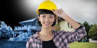 Composite image of female architect in hard hat standing against white background