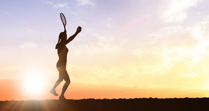 Composite image of female athlete playing tennis Stock Photography
