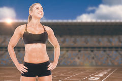 Composite image of female athlete posing with hands on hip Royalty Free Stock Images