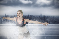 Composite image of female athlete posing after victory Stock Photography