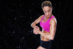 Composite image of female bodybuilder flexing in pink sports bra Stock Photography