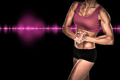 Composite image of female bodybuilder posing with hands together Royalty Free Stock Photography