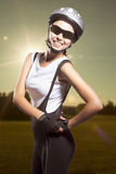 Composite image of a female cycling athlete against natural sunn Royalty Free Stock Photo