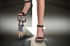 Composite image of female feet in black sandals standing on businesswoman Stock Images