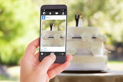Composite image of female hand holding a smartphone Royalty Free Stock Images