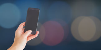 Composite image of female hand holding a smartphone 3d Stock Image