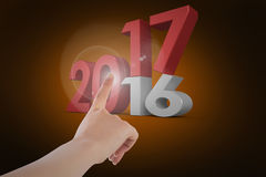 Composite image of female hand pointing. Female hand pointing against orange background with vignette Stock Photos