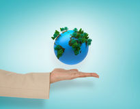 Composite image of female hand presenting blue earth Royalty Free Stock Images