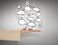 Composite image of female hand presenting cloud computing graphic Stock Photo