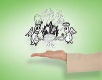 Composite image of female hand presenting good vs evil Stock Photos