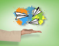 Composite image of female hand presenting paper airplanes Stock Image