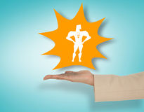 Composite image of female hand presenting superhero Royalty Free Stock Image