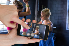 Composite image of female trainer instructing woman in gym stock photography