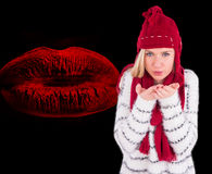 Composite image of festive blonde blowing over hands Royalty Free Stock Image