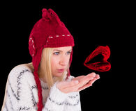 Composite image of festive blonde blowing over hands Royalty Free Stock Images