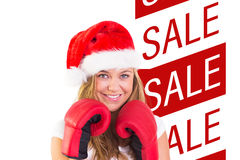 Composite image of festive blonde with boxing gloves Royalty Free Stock Images