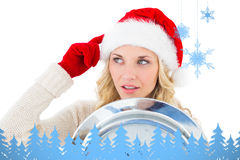 Composite image of festive blonde holding large clock Royalty Free Stock Images